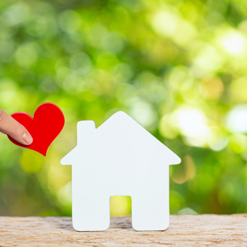 house-hand-holding-paper-heart